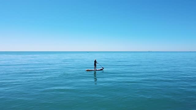 woman on paddle board, sandgate, kent, england, uk - water sport stock videos & royalty-free footage