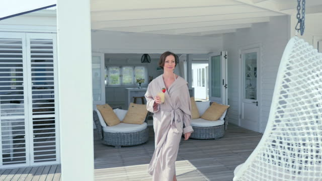 woman on patio - bathrobe stock videos & royalty-free footage