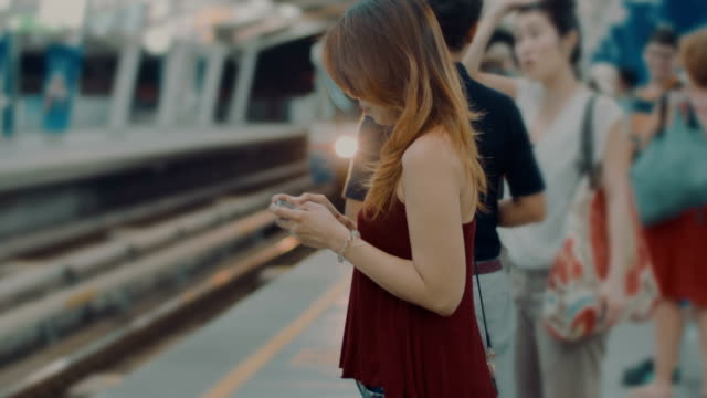 woman on phone at station - underground train stock videos & royalty-free footage