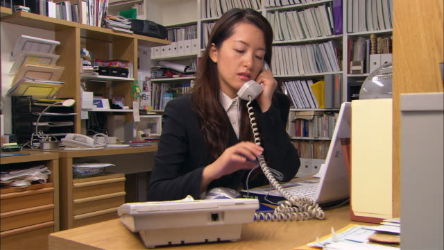 CU, Woman on phone in office