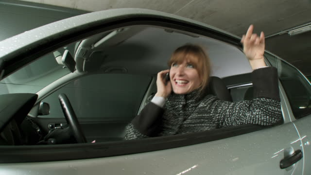 HD DOLLY: Woman On Phone In The Car