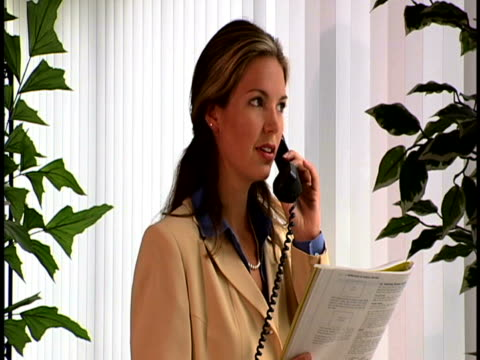 woman on phone - formal businesswear stock videos & royalty-free footage