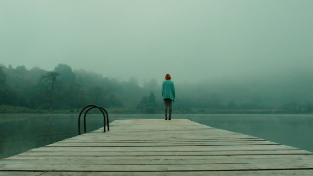 woman on pier at lake - pier stock videos & royalty-free footage