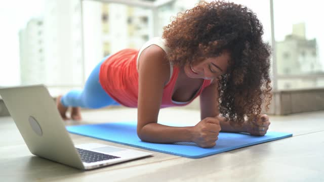 woman on plank position doing exercise at home - plank stock videos & royalty-free footage