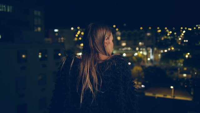 woman on rooftop - rooftop stock videos & royalty-free footage