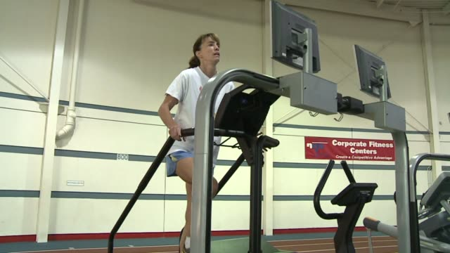 stockvideo's en b-roll-footage met woman on stairmaster at national institute for fitness and sport on october 06 2013 in indianapolis indiana - ellips