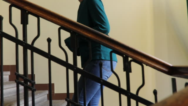 woman on stairs - steps and staircases stock videos & royalty-free footage