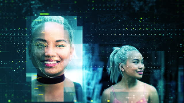 stockvideo's en b-roll-footage met woman on street face being scanned by facial recognition technology - identity