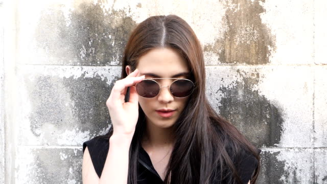 woman on street - sunglasses stock videos & royalty-free footage