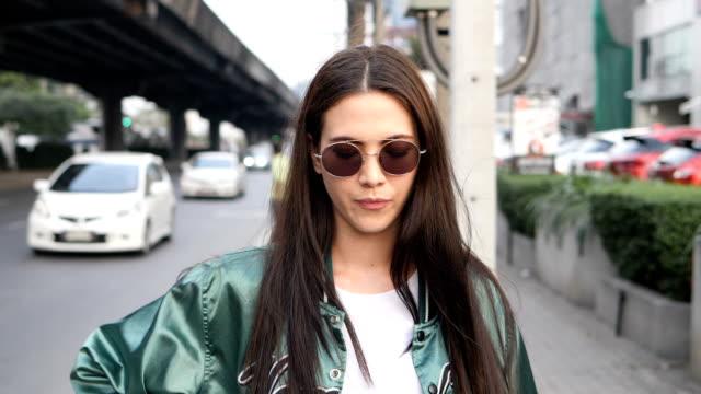 woman on street - sunglasses stock videos & royalty-free footage