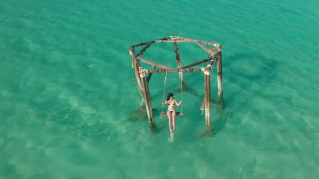woman on swing in sea - bahamas stock videos & royalty-free footage