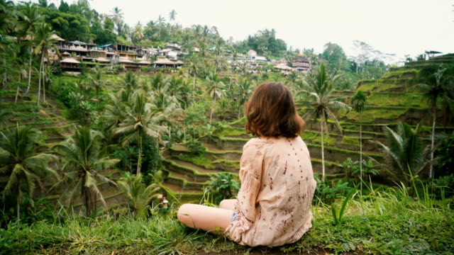 woman on tegallalang rice field in bali, indonesia - summer stock videos & royalty-free footage