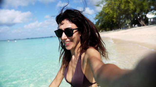Woman on the beach - Amazing vacation in wintertime in the Caribbean Sea - Cayman Islands