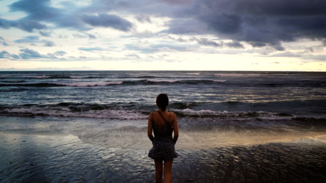 woman on the beach at sunset  on bali - horizon stock videos & royalty-free footage