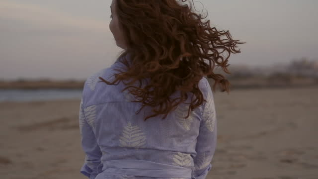 woman on the beach - hair toss stock videos & royalty-free footage