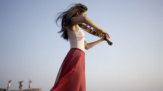 woman on the mountain playing the violin . - violin stock videos & royalty-free footage