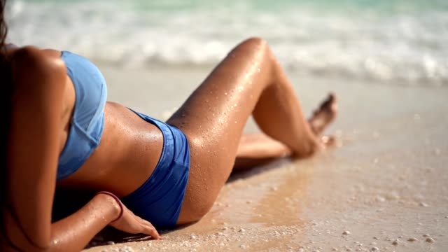 woman on the paradise beach enjoying waves - swimwear stock videos & royalty-free footage