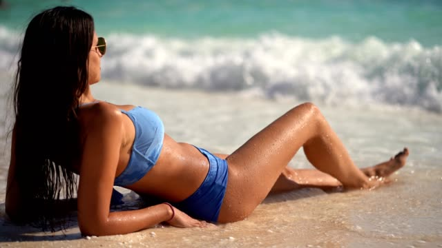 woman on the paradise beach enjoying waves - sunbathing stock videos & royalty-free footage