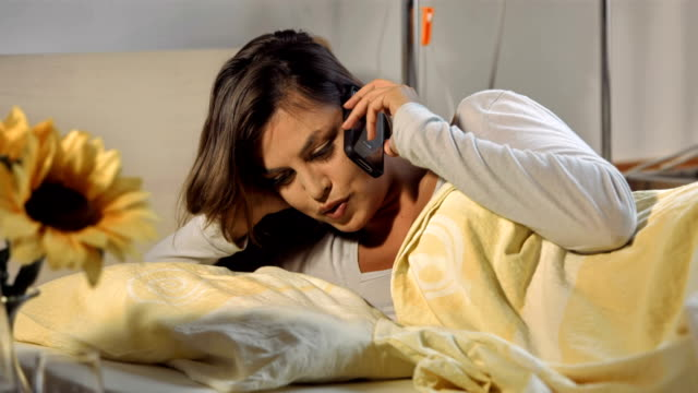 HD: Woman On The Phone In Bed