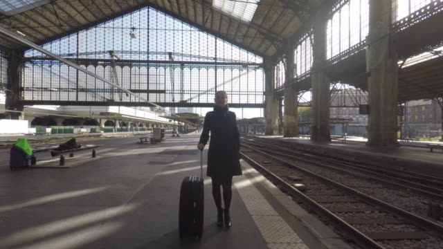 woman on the platform of a train station - railway station platform stock videos & royalty-free footage