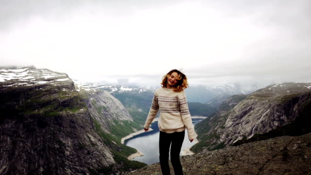 woman on trolltunga - pullover stock videos & royalty-free footage