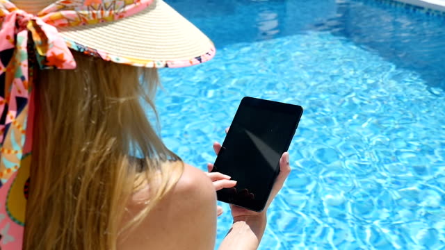 Woman on vacation using tablet