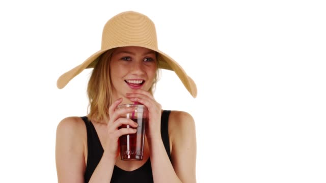 woman on white background drinking iced tea and calling to friend with copyspace - solid stock videos & royalty-free footage