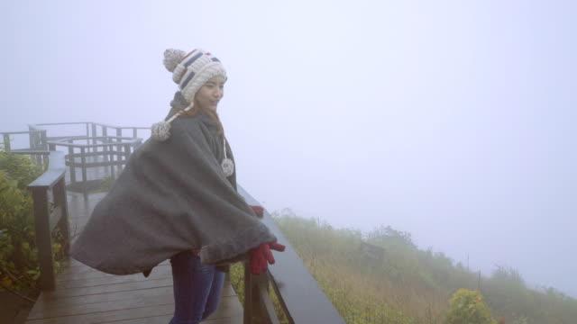 Woman on windy mountain
