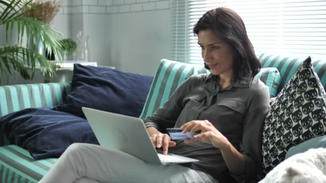 Woman online shopping on Laptop at home