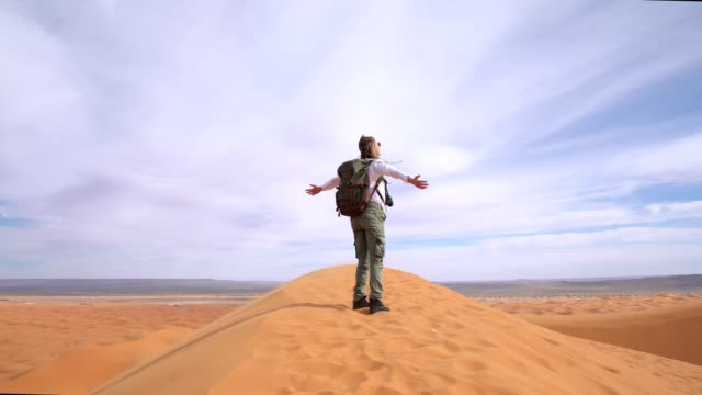 woman open arms on desert - arms outstretched stock videos and b-roll footage