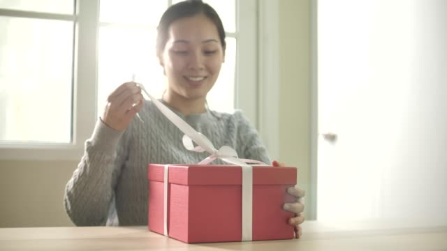 woman open gift box at home - birthday gift stock videos & royalty-free footage