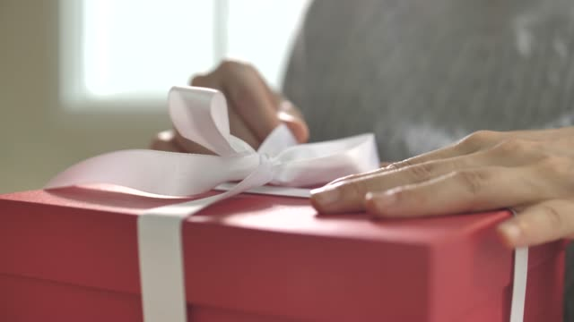 woman open gift box at home, wrapping gifts - negative emotion stock videos & royalty-free footage