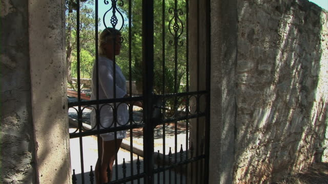 woman open iron door - gate stock videos & royalty-free footage