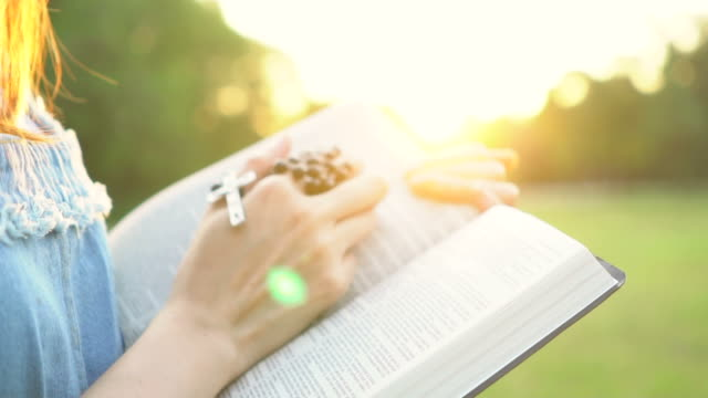 woman open the bible and cross hanging over - gospel stock videos & royalty-free footage