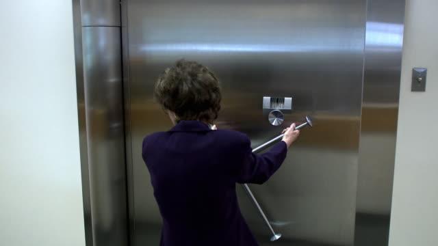 MS Woman opening bank vault door, Bethlehem, Pennsylvania, USA