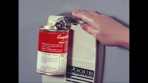 cu woman opening can of campbell's tomato soup using electric can opener / united states - soup stock videos & royalty-free footage