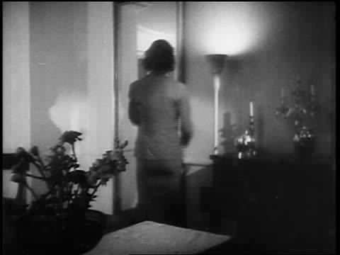 vídeos y material grabado en eventos de stock de b/w 1935 woman opening closet door / educational - 1935