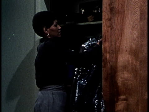 1965 MONTAGE woman opening closet door, reacting to crying baby / United States