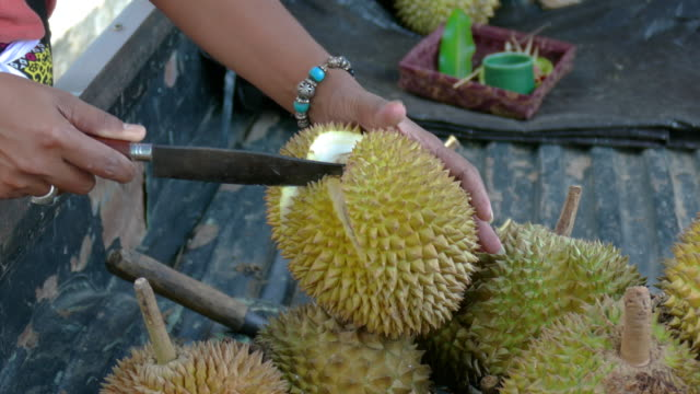 cu woman opening durian fruit with knife, ubud, bali, indonesia - ubud stock videos & royalty-free footage