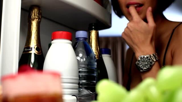 CU Woman opening fridge and taking cake / Brussels, Belgium