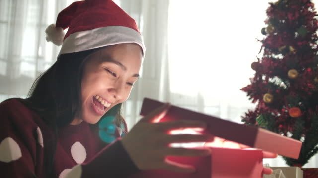 woman opening gift box in christmas at home - gift box stock videos & royalty-free footage