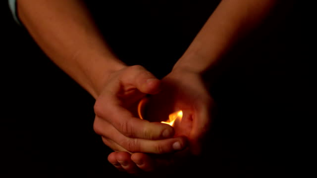 woman opening hands to reveal fire - flame stock videos & royalty-free footage