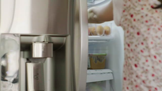 woman opening home refrigerator - refrigerator stock videos & royalty-free footage