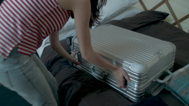 woman opening luggage in yurt - denim jacket stock videos and b-roll footage