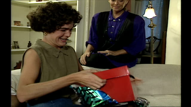 stockvideo's en b-roll-footage met woman opening present to reveal nintendo game boy - 1980 1989