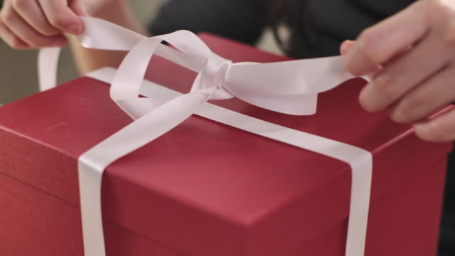 woman opens a gift box at home, unwrapping gift box - crate stock videos & royalty-free footage