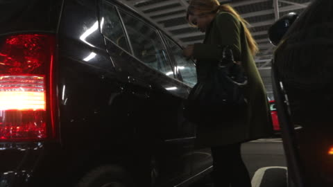 woman opens door to suv in garage - sports utility vehicle stock videos & royalty-free footage