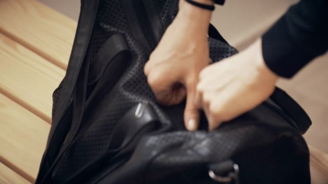 woman opens gym bag - locker room stock videos and b-roll footage