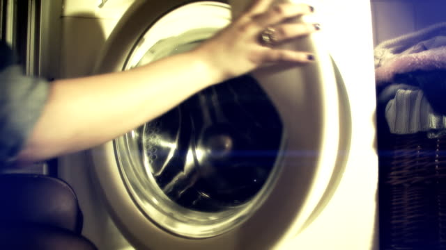 Woman opens old fashioned washer
