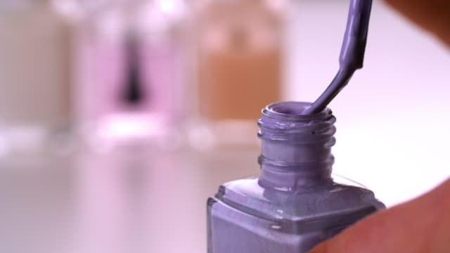woman opens purple nail polish bottle - femininity stock videos & royalty-free footage
